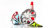 pic of alloy  - car accessories with alloy wheel and traffic cone - JPG