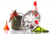 foto of cone  - car accessories with alloy wheel and traffic cone - JPG