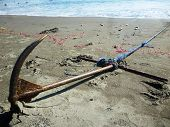 pic of penetration  - anchor rope chain penetrates the sand beach - JPG