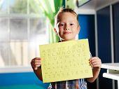 picture of homework  - little boy holding completed homework - JPG