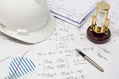 picture of structural engineering  - Desk of Civil Design Engineer who has just made structural analysis calculations - JPG