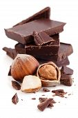 pic of hazelnut  - Stack of pieces of dark chocolate and hazelnuts - JPG