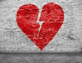 foto of love hurts  - Shape of broken heart painted on brick wall - JPG