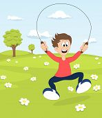 pic of skipping rope  - A boy playing with the skipping rope on blooming meadow - JPG