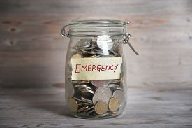 image of emergency light  - Coins in glass money jar with emergency label - JPG