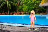 image of flipper  - cute girl with flippers in swimming pool at tropical beach - JPG