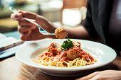 pic of meatball  - portrait image of woman eating spaghetti meatball - JPG