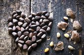 foto of pine nut  - the heart of the pine nuts and shells on the wooden table - JPG