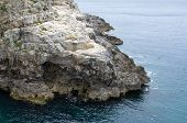 picture of extend  - Rocky Coast Extending into the Blue Sea - JPG