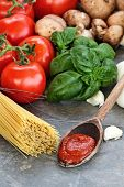 foto of basil leaves  - Spaghetti sauce with pasta basil leaves garlic and fresh tomatoes with extreme shallow depth of field - JPG