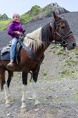 pic of mountain chain  - girl riding a horse in the mountains - JPG