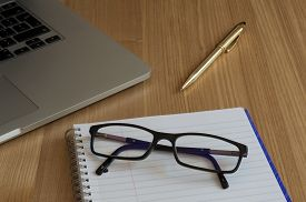 pic of qwerty  - Spectacles on a pad of paper - JPG