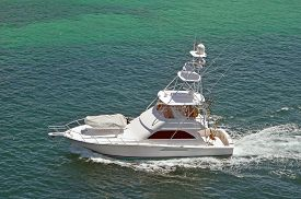 picture of boat  - Sport fishing boat with flying bridge cruising near Nassau in the Bahamas - JPG