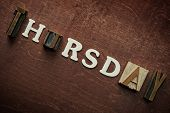 The word thursday written on wooden background