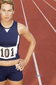 stock photo of bare midriff  - Female athlete on running track - JPG