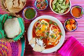 picture of poblano  - Breakfast Mexican ranchero eggs with chili and nachos Mexico flavor - JPG
