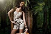 Beauty woman in the tropical forest