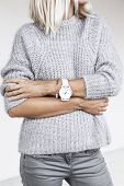 Unrecognizable model wearing casual outfit. Gray clothing in trendy minimalistic style. Street fashi poster