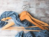Wooden Clothes Hangers. What To Wear poster
