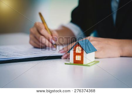 Businesswoman Signing The Document Contract