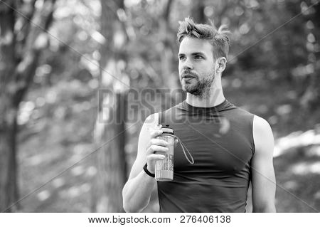 poster of Just A Minute To Rest. Man Athletic Appearance Holds Bottle With Water. Man Athlete In Sport Clothes