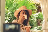 Beautiful Woman Drinking Coffee. Healthy People Lifestyle. Woman Relaxing In Coffee Place. .vacation poster