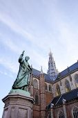 Cathedral St. Bavo with statue of printing inventor Laurens Janszoon Coster