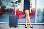 Cropped Image Traveler Tourist Woman Crossed Legs In Summer Casual Clothes With Suitcase On Road In  poster