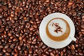 Top View Of Coffee Cup With Coffee Beans.