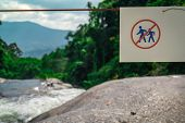 Do Not Walk Of The Trail. Warning Sign In National Park At Waterfall In Green Tropical Forest And Mo poster