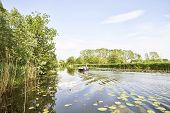 Cruising on the river Gein in summertime in the Netherlands