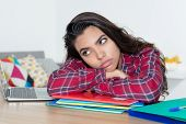 Lonely Teenage School Girl Thinking About The Life At Home At Desk poster