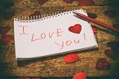 I Love You Its Written In Red In A Notebook. Declaration Of Love. Valentines Day. The Concept Of Lov poster