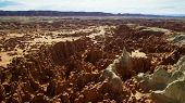 Rocky Deserts Are Scorched By The Sun And Scoured By Windblown Sand. Desert Rock Is Shaped Into Stra poster