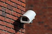 Security Cctv Camera On Brick Wall Facade