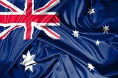 National Flag Of Australia Hoisted Outdoors With Sky In Background. Australia Day Celebration poster