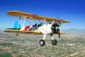 image of orifice  - A Stearman flies in formation over the Arizona desert - JPG
