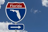 Road Trip To Florida, Red, White And Blue Interstate Highway Road Sign With Word Florida And Map Of  poster