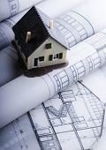 Close up of a blueprint & House