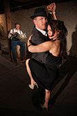 image of debonair  - Lovely woman in black with male dancing partner performing tango - JPG