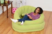 stock photo of cornrow  - top view of a happy young black child relaxing - JPG