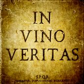 In Vino Veritas Sign On A Stone Textured Bacground And S.p.q.r. Innitials