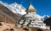 buddhist stupa with mount Lhotse - way to everest base camp