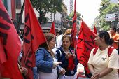 Female Protesters With Red Flags