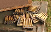 stock photo of projectile  - A Display of Vintage Heavy Duty Gun Bullets - JPG