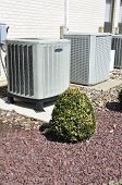 picture of air conditioner  - two outdoor air conditioner compressor units for a commercial property - JPG
