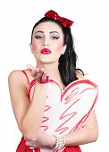 Isolated Pin Up Woman Holding A Heart Shaped Sign