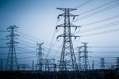 stock photo of power transmission lines  - High voltage towers with sky background - JPG