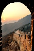 Great Wall sunset through window over mountains in Beijing, China.