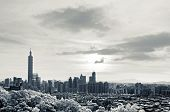 Cityscape with 101 skyscraper under dramatic clouds, infrared photography in Taipei, Taiwan, Asia.